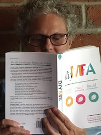 blog author reading DIY MFA book
